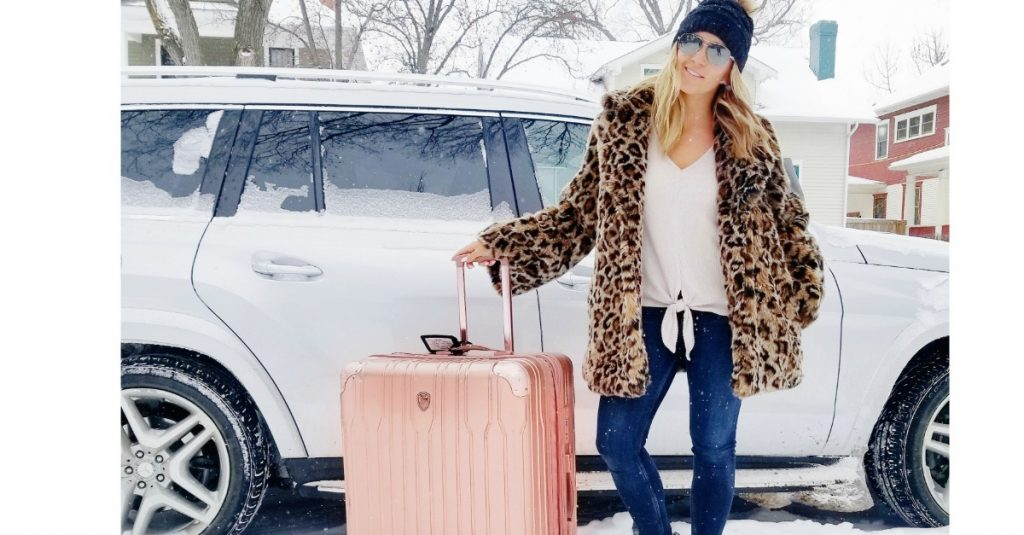 Leopard Print Coat + Rose Gold Luggage