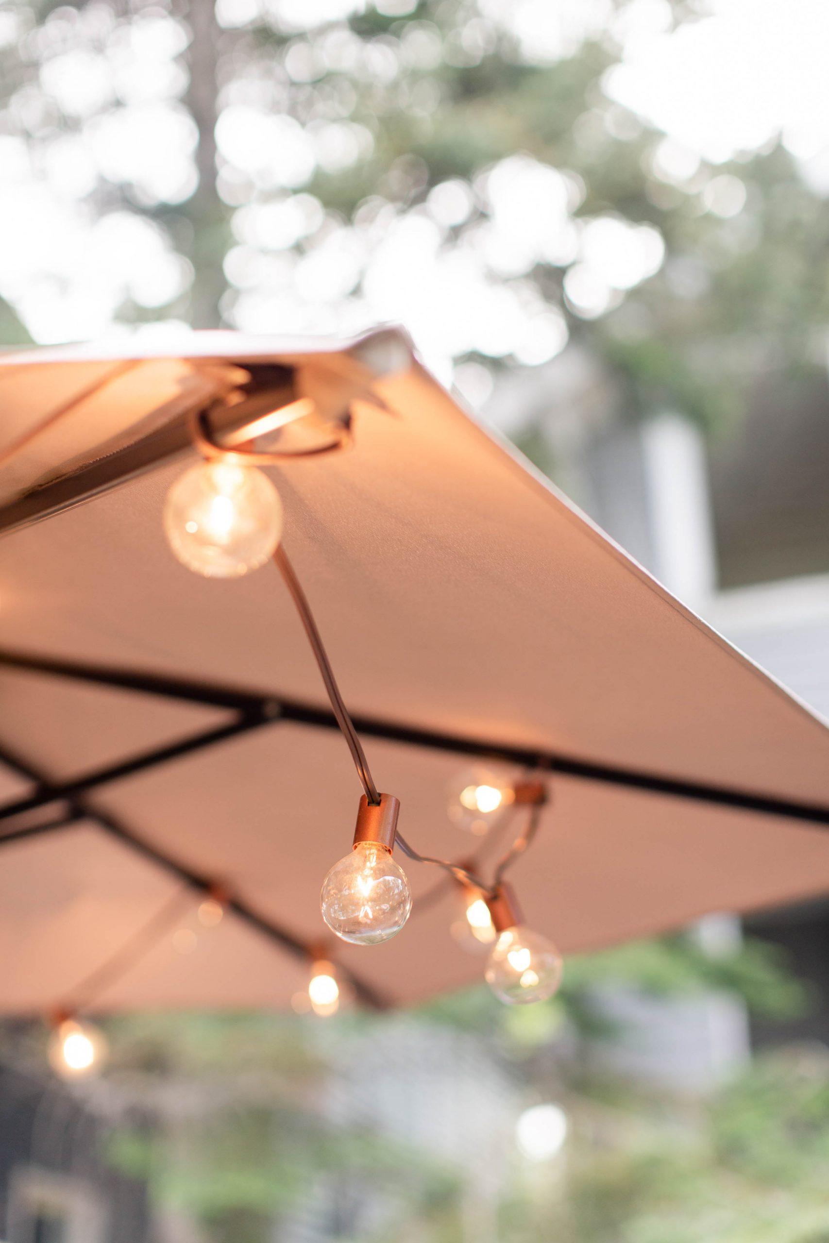 mini bulb lights strung through patio umbrella