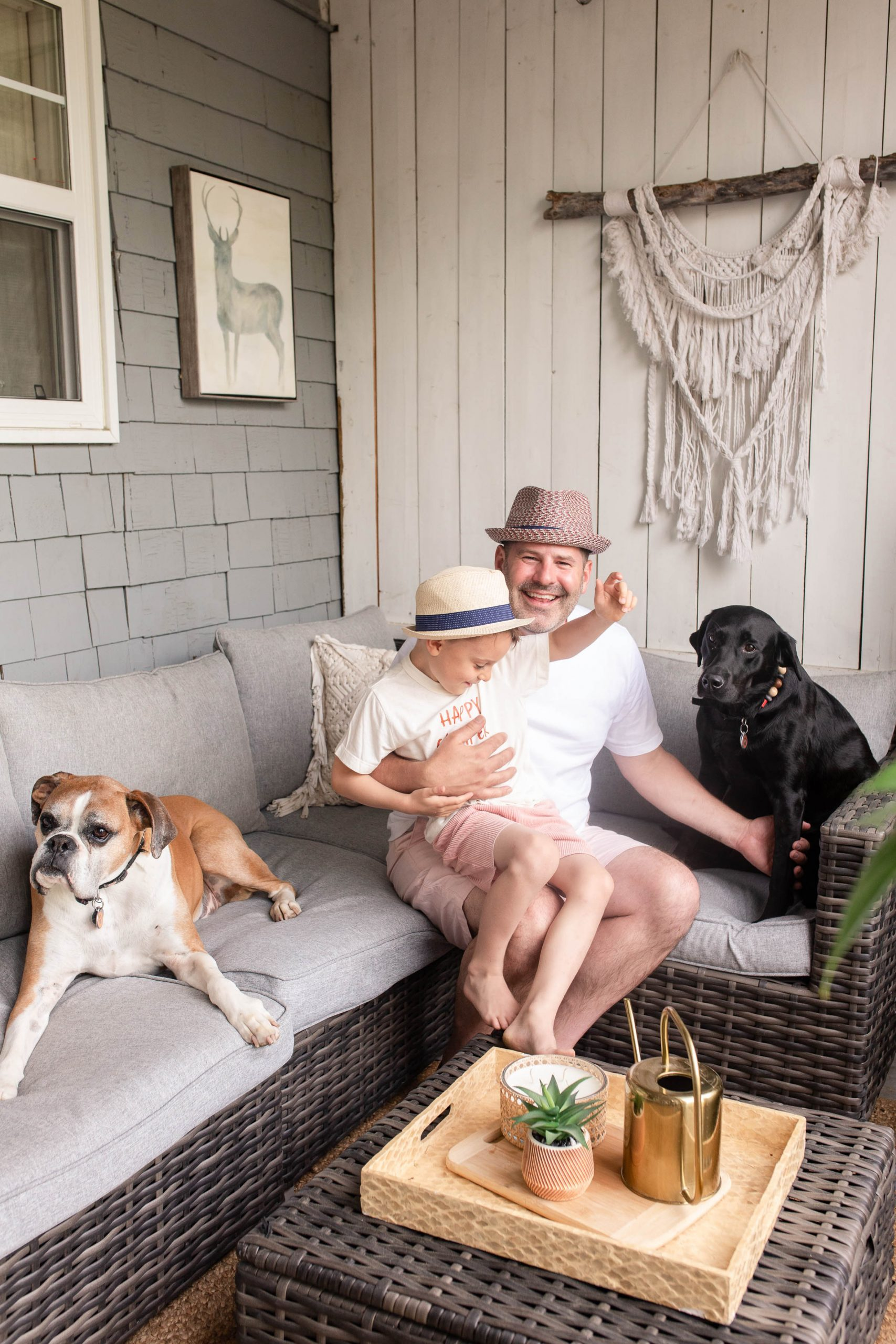 Ryan Jespersen with son and his dogs